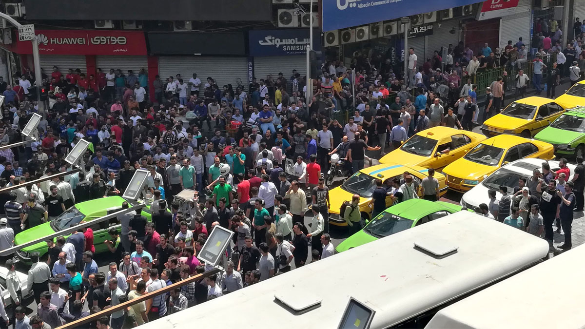 Partner Content - IRAN ON EDGE: Anti-Regime Protests Spread to '100 Cities' After Tehran R...