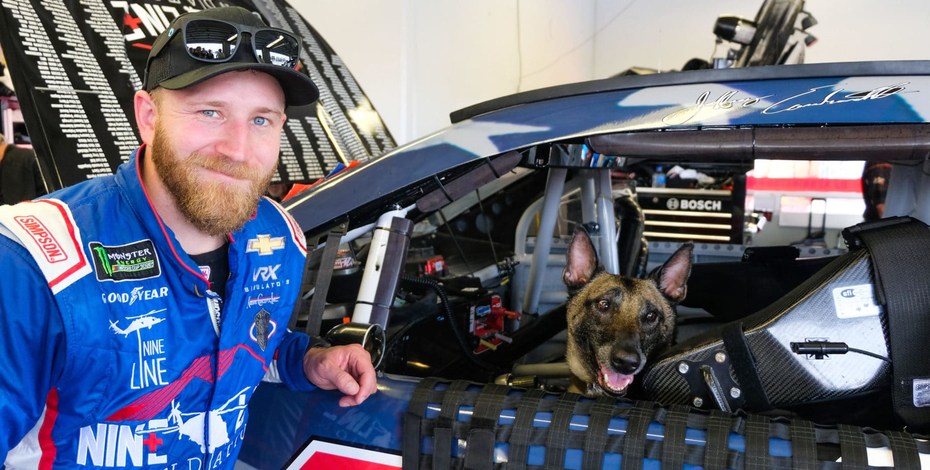 Jeffrey Earnhardt with Xtreme Concepts' explosive detection, patrol and tracking dog, Hennessy.