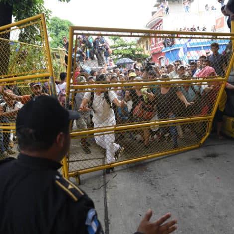 CARAVAN DEFIANT: Migrants 'Crash Gates,' Head into Mexico