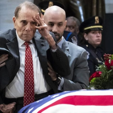MUST SEE: Bob Dole Rises from Wheelchair, Gives 'Standing Salute' to President George H.W. Bush