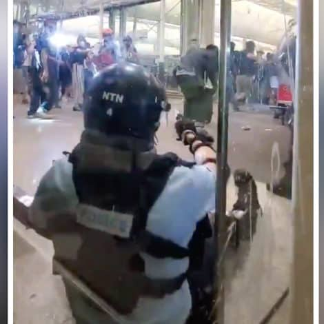 HONG KONG ERUPTS: Riot Police Officer Aims His Pistol at Protesters, Situation Escalating