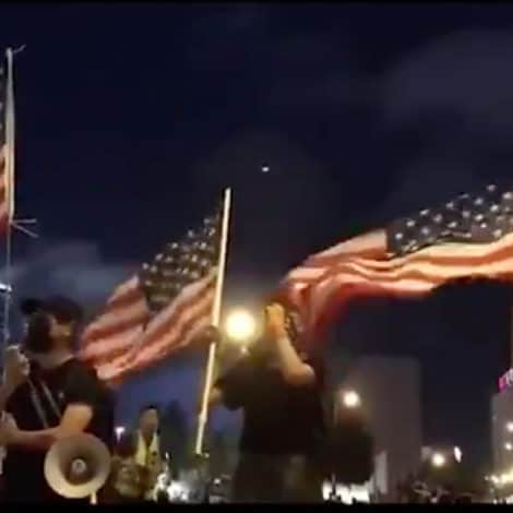 WATCH: Pro-Democracy Protesters in Hong Kong Wave US Flag, Sing 'Star-Spangled Banner'