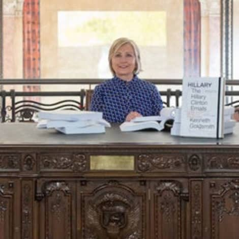 NEXT LEVEL SAD: Hillary Clinton Reads Her Emails Behind Replica of Oval Office Desk at Art Exhibit